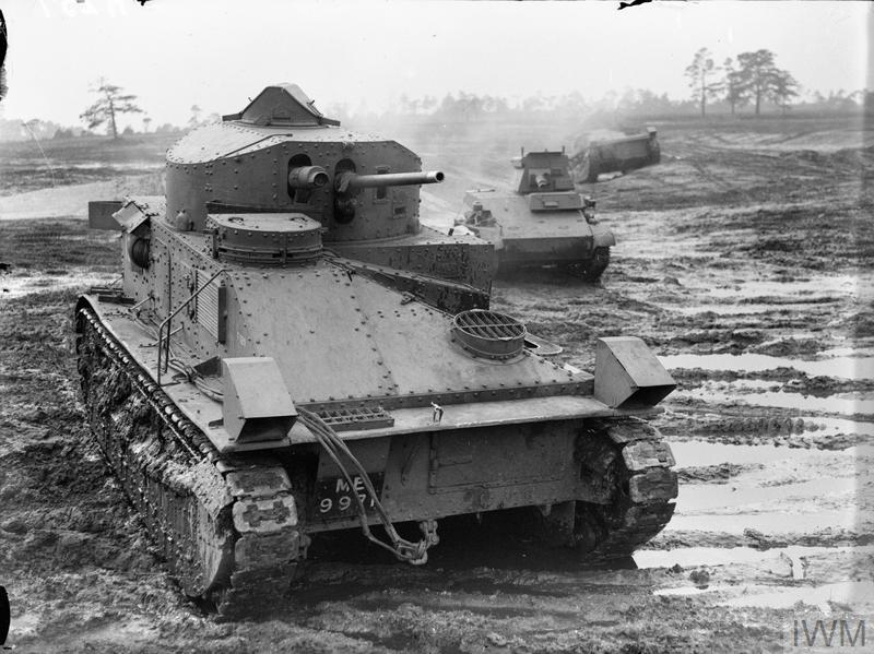 Vickers Medium Mk II tank at Bovington Camp in Dorset, November 1939. A Light Tank Mk IV can be seen in the background.