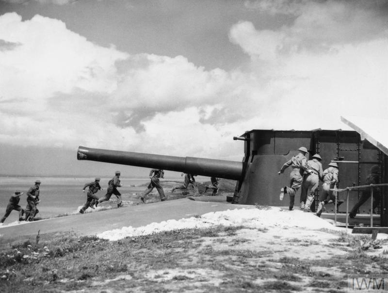 Gunners run to take post at a 9.2-inch coastal defence gun at the Needles Battery on the Isle of Wight, 7 August 1941.
