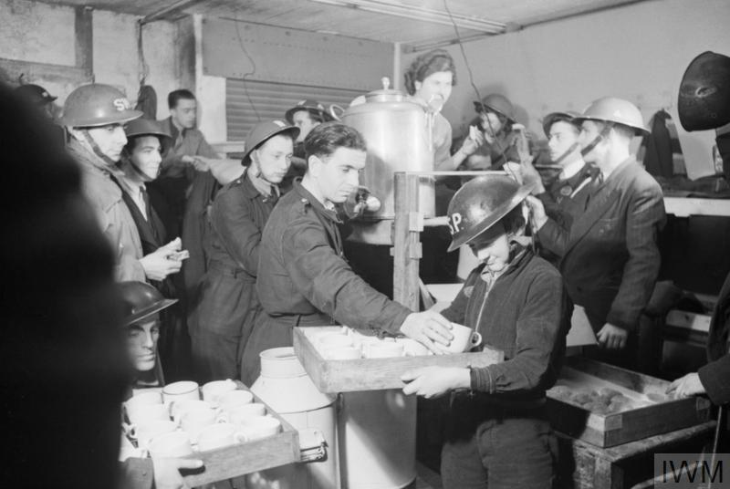 LIFE IN A BASEMENT AIR RAID SHELTER, SOUTH EAST LONDON, ENGLAND, 1940