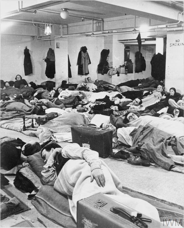LIFE IN A BASEMENT AIR RAID SHELTER, LONDON, ENGLAND, 1940
