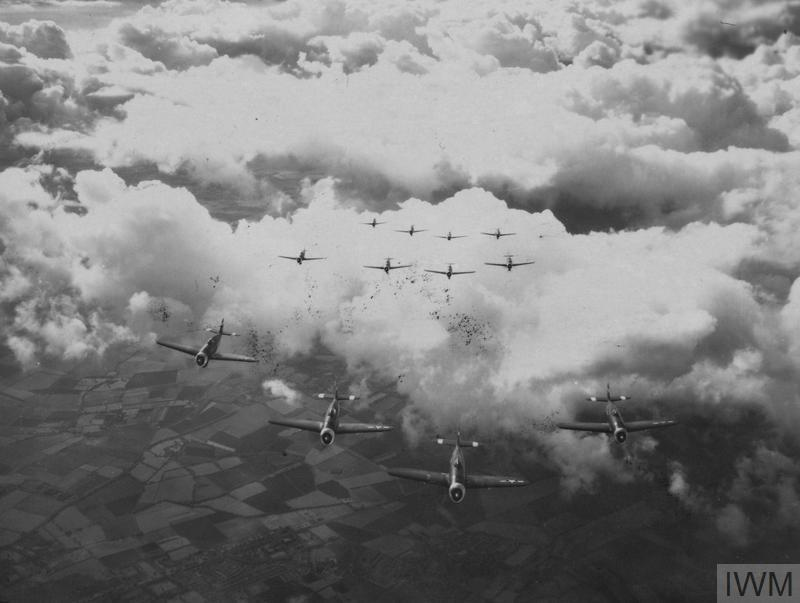 © IWM [FRE 3035] - P-47 Thunderbolts of the 78th Fighter Group fly in formation.