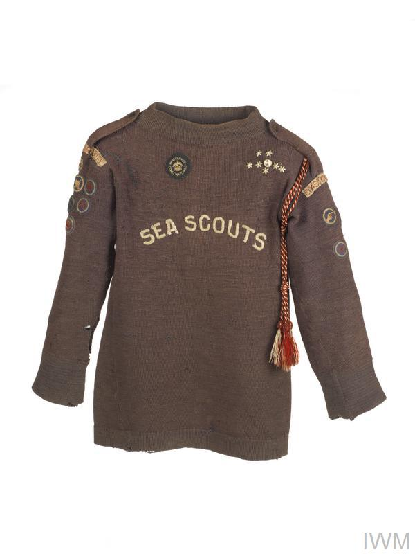 Jumper worn by a Sea Scout in the First World War. The badge just below the neck of this jumper was awarded for coast-watching.