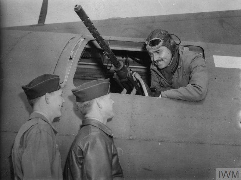 Captain Clark Gable speaks to Sergeant Phil Hulse and Sergeant Kenneth Huls of the 351st Bomb Group, June 1943.