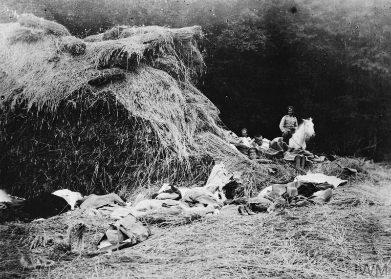 Nurses and Russian Army personnel attached to the Red Cross unit of Florence Farmborough sleeping in a haystack.