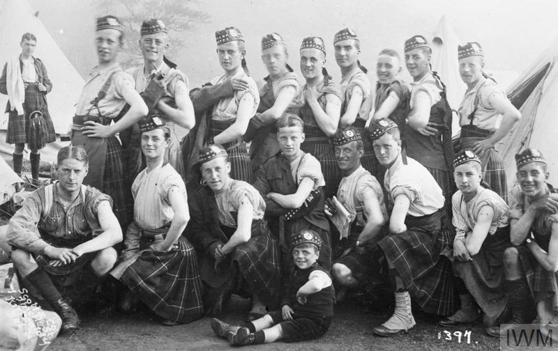Soldiers of the Liverpool Scottish show off their arms after being vaccinated, c.1914.