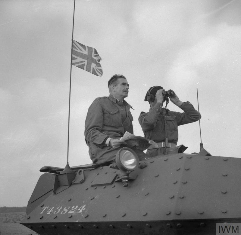 Anthony Eden, the Foreign Secretary, in the turret of a Crusader tank, watching an exercise involving 42nd Armoured Division near Malton in Yorkshire, 29 September 1942.