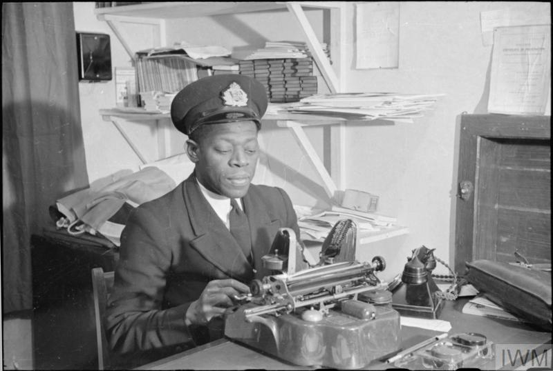 Mr Koi Obuadabang-Larbi, BA, Superintendent of West Indies House, a Merchant Seamen's Hostel works at the typewriter in his office.