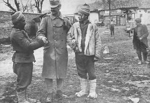 An Austro-Hungarian soldier shaking hands with Bulgarian reservists, 1917. THE CENTRAL POWERS IN THE MACEDONIAN CAMPAIGN, 1915-1918