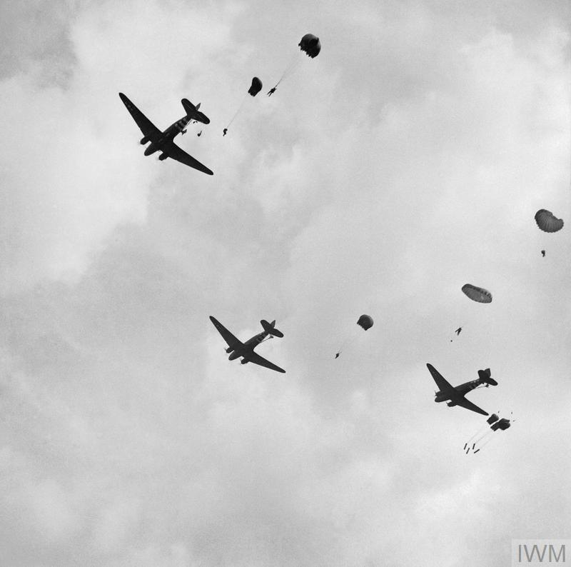 Paratroopers and 'parapack' supply containers drop between Heelsum and Wolfheze, west of Arnhem, on 17 September 1944.