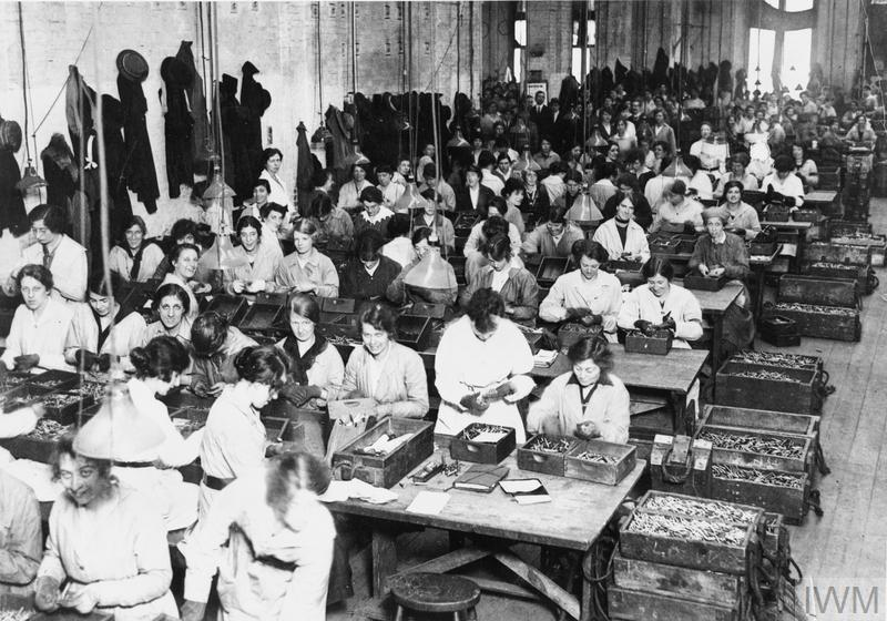 Female workers in the examination room where cartridges and bullets are given their final inspection.