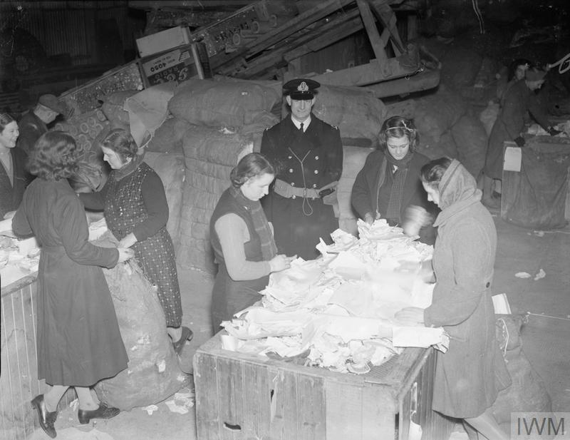 DESTRUCTION OF CONFIDENTIAL AND SECRET PAPERS UNDER ARMED GUARD. 1940 OR 1941. CONFIDENTIAL PAPERS ARE COLLECTED FROM THE NUMEROUS OFFICES EVERY WEEK THEN CONVEYED TO PAPER MILLS, WHERE THEY ARE THEN SORTED IN CASE OF ANY UNOPENED LETTERS BEING AMONGST THEM. THEN THE LETTERS ARE PUT INTO A CAUSTIC VAT AND BOILED FOR FIVE HOURS. THEY ARE THEN ABLE TO BE USED AGAIN. THE ADMIRALTY RECEIVES QUITE A SUM FROM THE MILL IN THE COURSE OF A YEAR.