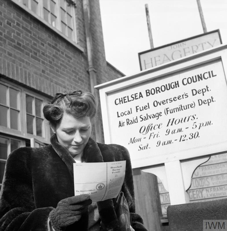 Newly-engaged Marcelle Lestrange looks at her permit for Utility furniture which she has just received from Chelsea Borough Council.