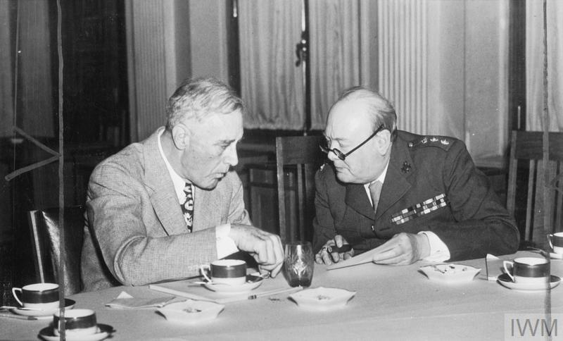 President Roosevelt and Winston Churchill confer during a lunch break at the Livadia Palace during the Yalta Conference.