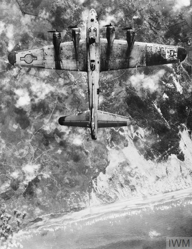 © IWM (EA 31796) A B-17G of the 100th Bomb Group bombing beach defences near Boulogne, as part of the 'Overlord' deception plan, 5 June 1944.