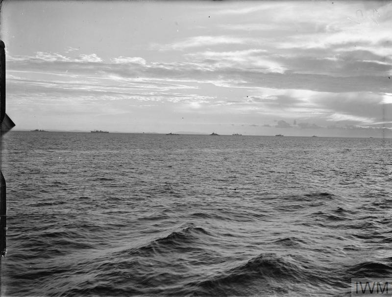 FLEET ACTION SOUTH OF SARDINIA ON 27 NOVEMBER 1940. ON BOARD THE CRUISER HMS SHEFFIELD DURING THE ACTION. IN THE MORNING OF THE 27TH FORCES OPERATING TO THE WESTWARD OF SARDINIA RECEIVED REPORTS FROM RECONNAISSANCE AIRCRAFT THAT ENEMY FORCES CONSISTING OF 2 BATTLESHIPS AND A LARGE NUMBER OF CRUISERS AND DESTROYERS WERE AT SEA ABOUT 75 MILES TO THE NORTH-EASTWARD. OUR FORCES INCREASED TO FULL SPEED AND ALTERED COURSE TO CLOSE THE ENEMY IN THE HOPE IN THE HOPE OF BRINGING HIM INTO ACTION. SERIES SHOWS THE FLEET DURING THE ACTION AGAINST THE ENEMY AND THE SUBSEQUENT ATTACK BY ENEMY AIRCRAFT, ETC.