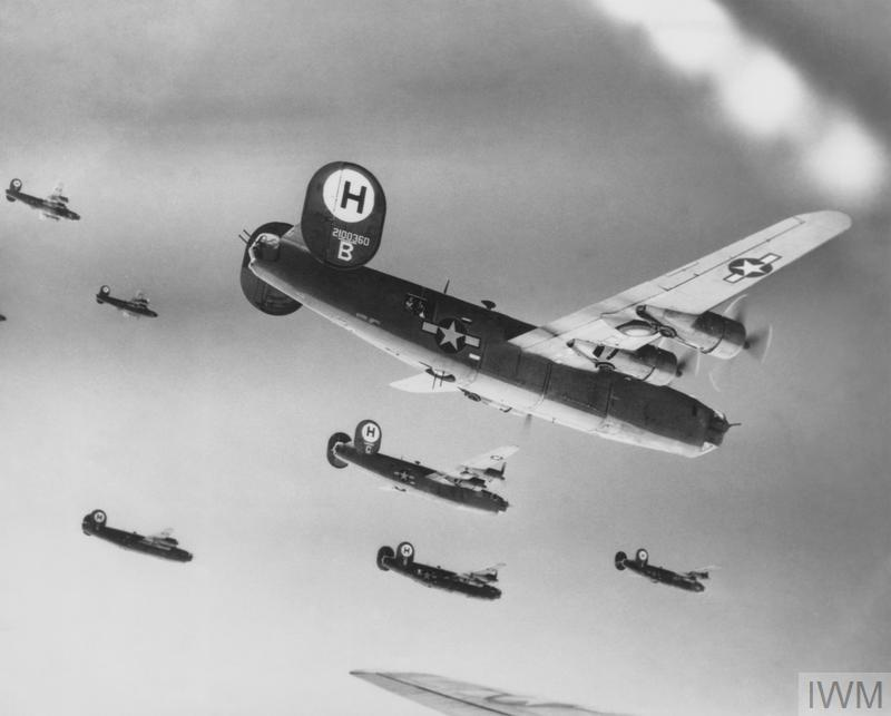 """© US Gov ( FRE 1753) B-24 Liberator (serial number 42-100360) nicknamed """"Luck and Stuff"""" flies in formation with other Liberators of the 446th Bomb Group during a mission"""