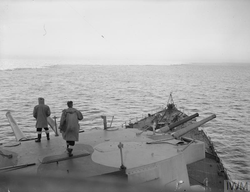 ON BOARD HMS SUFFOLK ON ARCTIC PATROL. JUNE 1941, ON BOARD THE CRUISER HMS SUFFOLK WHICH PLAYED A CRUCIAL ROLE IN THE SHADOWING OF THE BISMARCK ALONG WITH HMS NORFOLK.