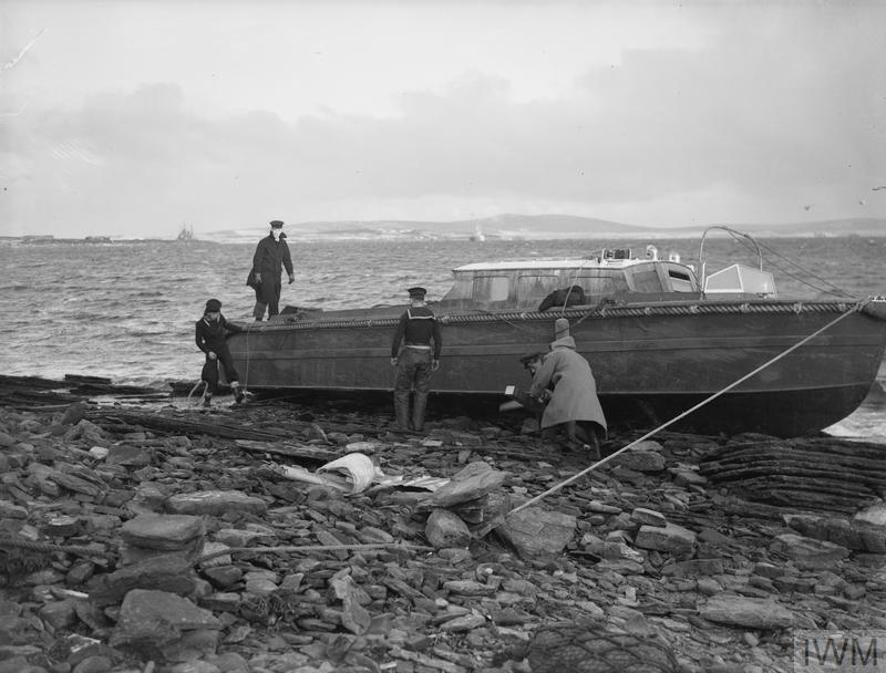 ATTEMPT TO SALVAGE MOTOR CUTTER WHICH HAD BROKEN FREE DURING A GALE. 5 JANUARY 1942, AT SCAPA.