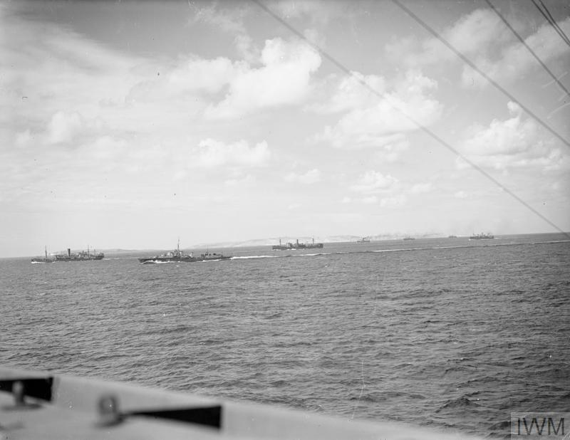 ITALIAN AIR ATTACK ON BRITISH CONVOY PROVES FUTILE AND COSTS ELEVEN BOMBERS. SEPTEMBER 1941, ON BOARD THE CRUISER HMS HERMIONE. ON ITS WAY THROUGH THE MEDITERRANEAN A LARGE BRITISH CONVOY TO MALTA (OPERATION HALBERD), WITH A ROYAL NAVY ESCORT UNDER THE COMMAND OF VICE ADMIRAL SIR JAMES SOMERVILLE, WAS DISCOVERED BY AN ITALIAN RECONNAISSANCE AIRCRAFT. LATER AN INTENSE ATTACK FROM THE AIR WAS ATTEMPTED BY THE ITALIANS, BUT THE AIRCRAFT FROM HMS ARK ROYAL, AND THE ANTI AIRCRAFT FIRE FROM THE WARSHIPS, GOT THE CONVOY THROUGH.