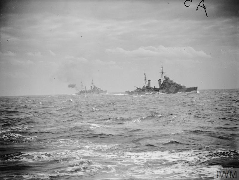 BOMBARDMENT OF DERNA, LIBYA BY THE ROYAL NAVY. DECEMBER 1941, ON BOARD ONE OF THE SHIPS TAKING PART IN THE BOMBARDMENT. DURING A DAYLIGHT RAID BY THE ROYAL NAVY ON DERNA HARBOUR.