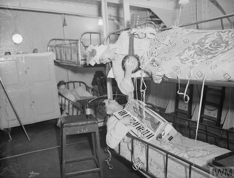 CHRISTMAS MUSIC IN THE SICK BAY. 22 DECEMBER 1941, ON BOARD HMS COCHRANE, ROSYTH.