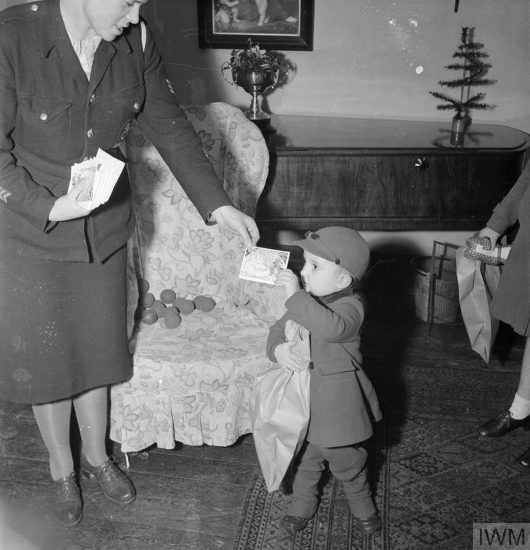 Derek Cunningham receives a Christmas card, savings stamp and gifts donated through the British War Relief Society.
