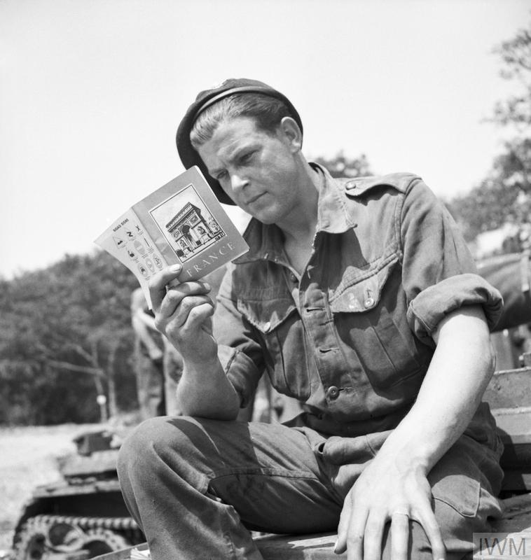 A soldier from 101st Light Anti-Aircraft Regiment (12th King's Regiment (Liverpool)) 3rd Division, prepares for D Day by reading at his French handbook at Camp A2 at Emsworth, near Portsmouth, Hampshire, 29 May 1944.
