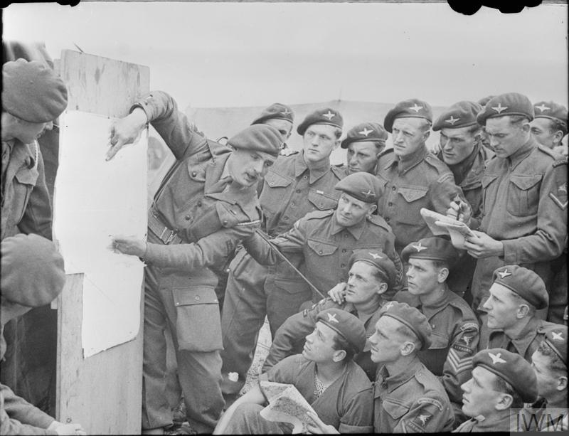 Men of 22nd Independent Parachute Company, 6th Airborne Division being briefed for the invasion, 4 - 5 June 1944.