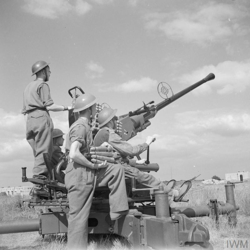 The crew of a Bofors anti-aircraft gun keep watch for V1 flying bombs, 19 June 1944.