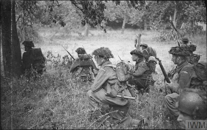 Men of 12 Platoon, 'B' Company, 6th Royal Scots Fusiliers, 15th (Scottish) Division, wait for the order to advance during Operation 'Epsom', 26 June 1944.