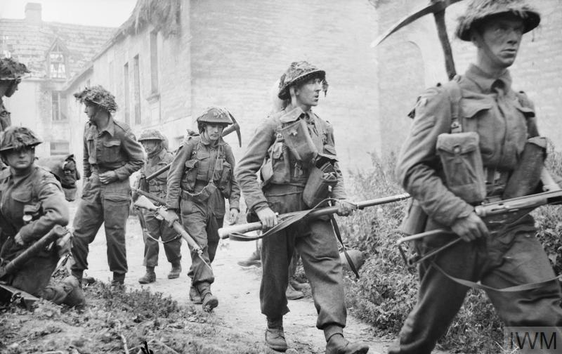 Infantry of 6th Royal Scots Fusiliers, 15th (Scottish) Division in the village of St Mauvieu-Norrey during Operation 'Epsom', 26 June 1944.