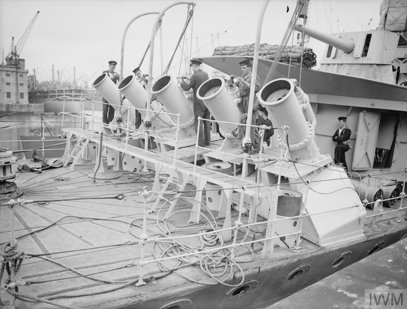 EXPERIMENTAL TESTS OF NEW DEPTH CHARGE THROWERS. 27 JULY 1941, ON BOARD HMS WHITEHALL. THE NEW THROWERS ARE FITTED ON THE FO'C'SLE OF DESTROYERS AND ARE OPERATED FROM THE BRIDGE.