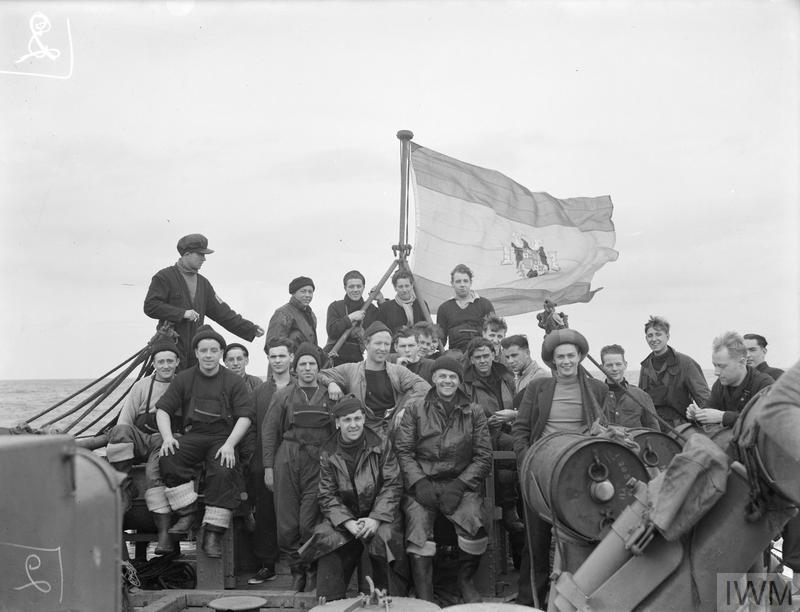 BOMBARDMENT OF ST JEAN DE LUZ. 4 AND 5 APRIL 1942, ON BOARD HMS CALPE, OFF ST JEAN DE LUZ. PREVIOUS TO THE ATTACK HMS CALPE FLEW THE SPANISH ENSIGN AND WHILE THIS WAS BEING FLOWN NO UNIFORMS WERE WORN BY ANY MEN APPEARING ON DECK. BEFORE THE BOMBARDMENT TOOK PLACE THE SPANISH ENSIGN WAS REPLACED BY THE WHITE ENSIGN.