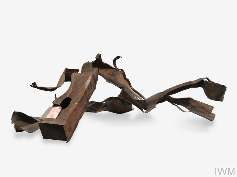 Section of twisted and rusted steelwork from the collapsed World Trade Center, New York; the piece comprises beams from the external walls of the building, and was originally located somewhere around one of the two impact zones.