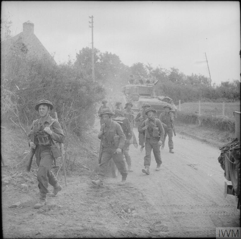 British troops moving up to the line during fighting in the Odon valley in Normandy, July 1944.