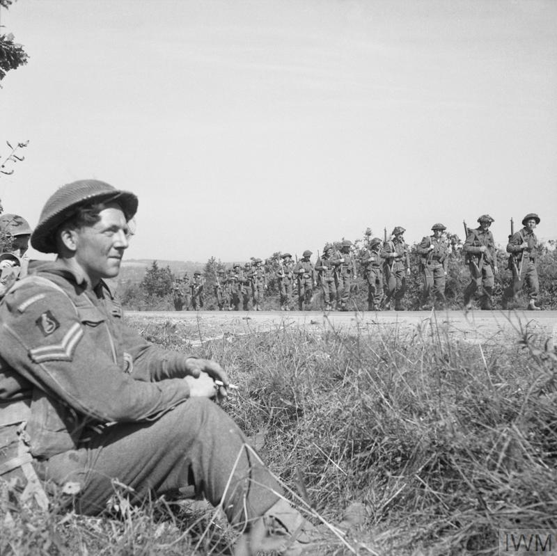 Men of the Durham Light Infantry move up during the fighting south of Mont Pincon, 9 August 1944.