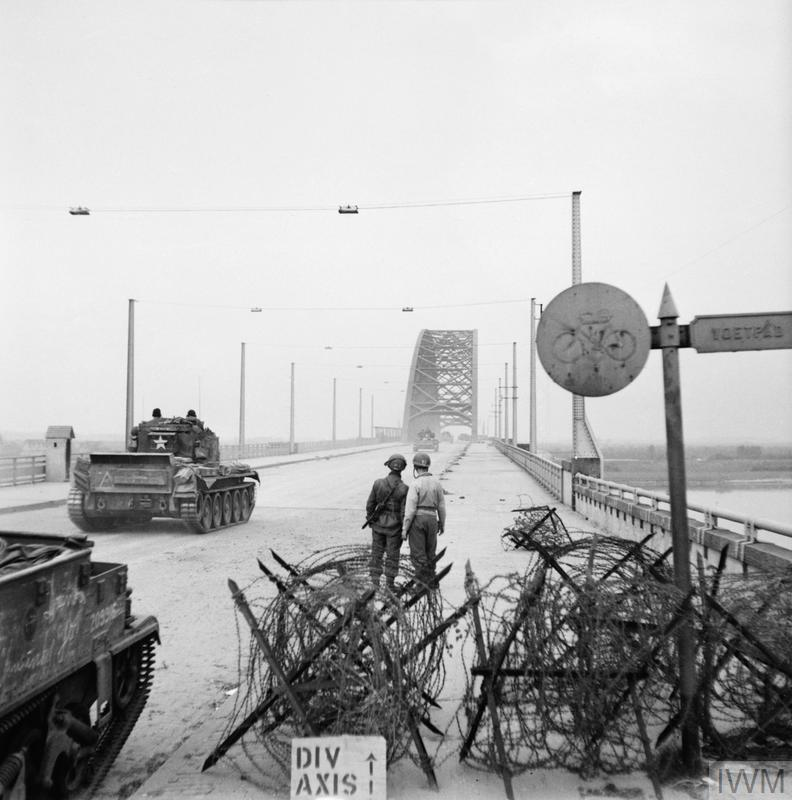 A Cromwell tank of 2nd Welsh Guards crosses the bridge over the River Waal at Nijmegen, 21 September 1944.