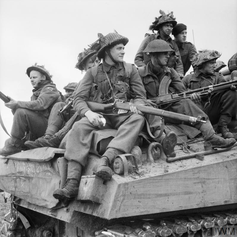 Infantry ride on Sherman tanks in Holland, 24 September 1944.