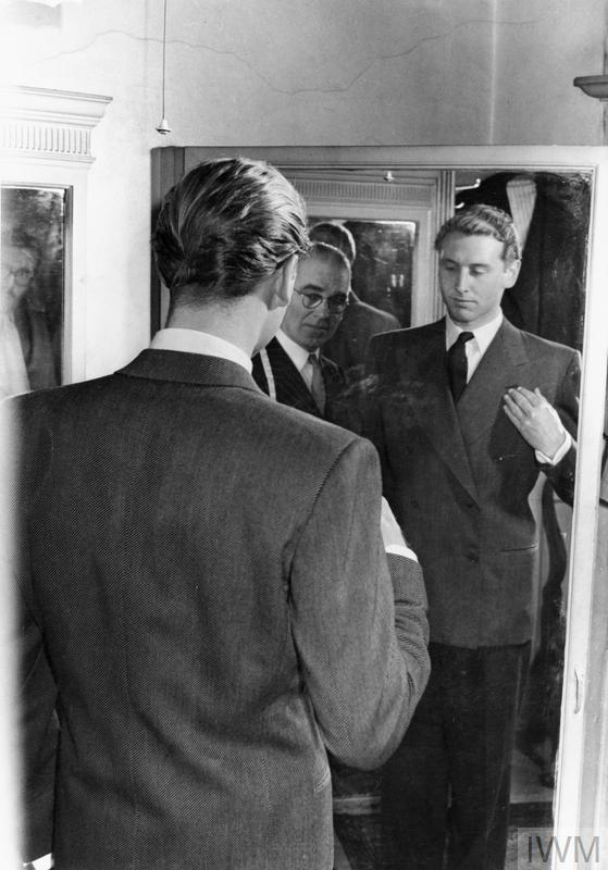A BELGIAN BUYS A SUIT: TAILORING IN WARTIME LONDON, ENGLAND, UK, 1944