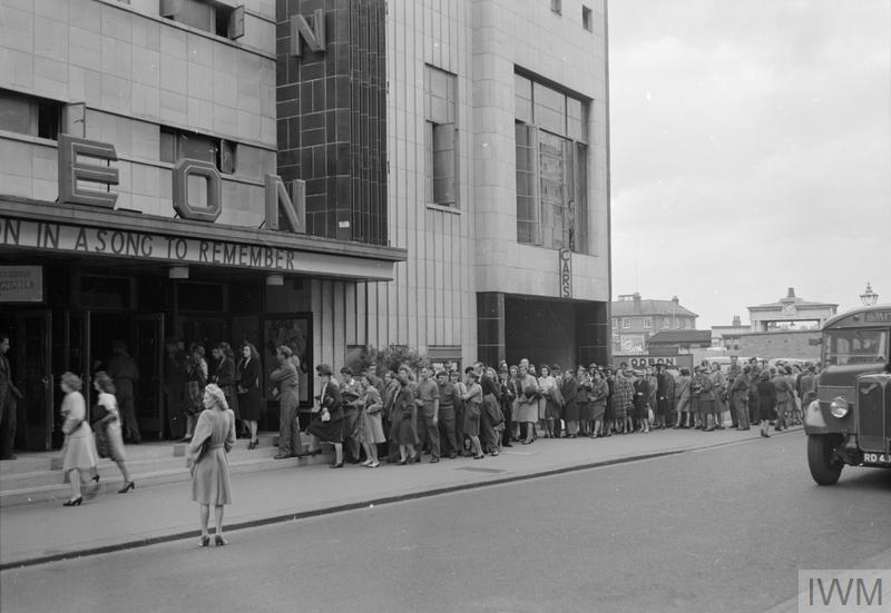 A long queue stretches out from the entrance of the Odeon Cinema in Reading, as people queue for tickets.