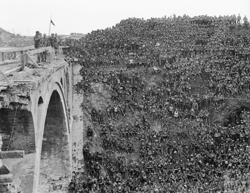 Vaughan Campbell VC addressing men of the 137th Brigade (46th Division) on the Riqueval Bridge over the St Quentin Canal (part of the Hindenburg Line) which they crossed on 29 September 1918. © IWM (Q 9535)