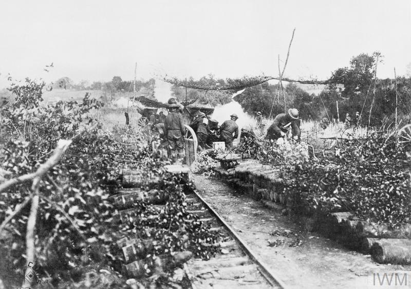 """American gunners of the """"A"""" Battery, 108th Field Artillery Regiment firing 75 mm guns near Varennes-en-Argonne, 3 October 1918. © IWM (Q 70711)"""