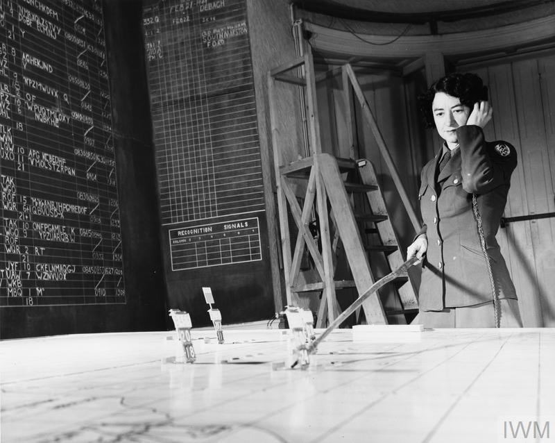 Corporal Geraldine Hill, Women's Army Corps, in the plotting room of 3rd Bomb Division, Elveden Hall, February 1944.