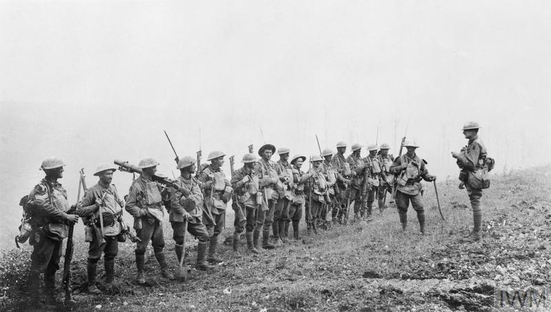 An under-strength platoon of the 5th Australian Division is addressed by an officer near Warfusee-Abancourt during the Battle of Amiens, 8 August 1918. © IWM (E (AUS) 2790)