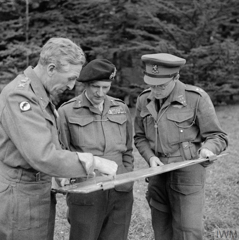 Field Marshal Montgomery studies a map with Lt-Gen Horrocks, GOC XXX Corps, and Prince Bernhard of the Netherlands, GOC all Dutch forces under Monty's command, 8 September 1944.