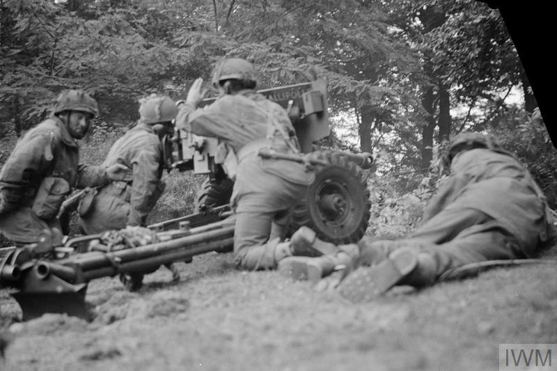 'Gallipoli II', a 6-pdr anti-tank gun of No. 26 Anti-Tank Platoon, 1st Border Regiment, 1st Airborne Division, in action in Oosterbeek, 20 September 1944. The gun was at this moment engaging a German PzKpfw B2 (f) Flammpanzer tank of Panzer-Kompanie 224 and successfully knocked it out.