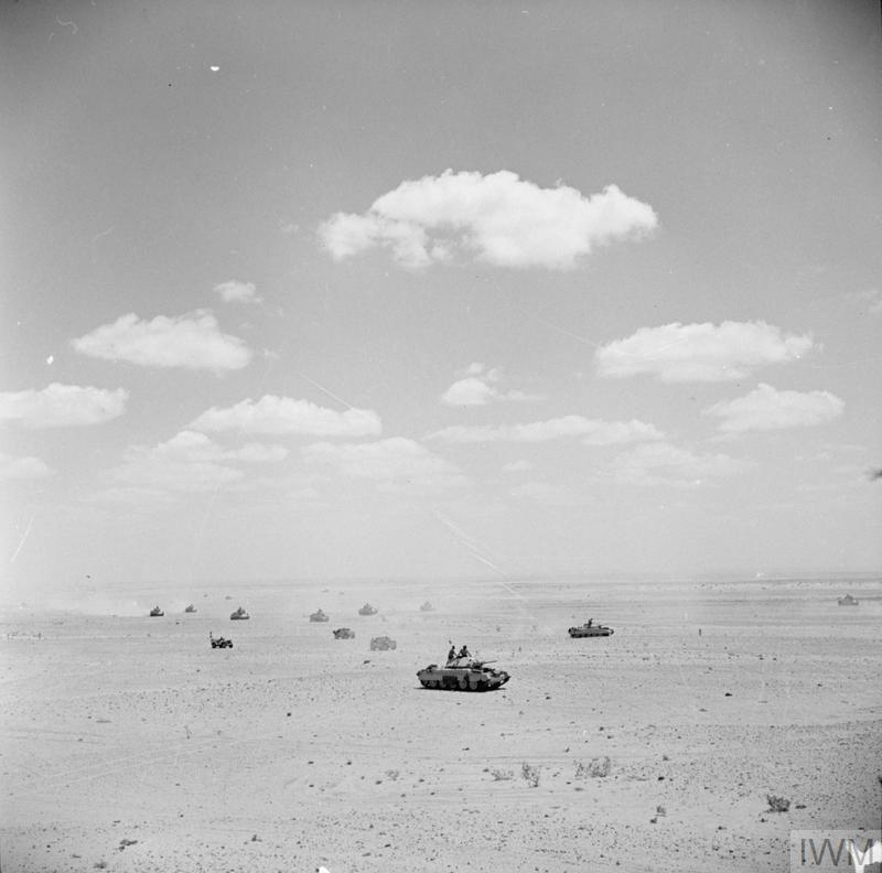 Crusader tanks and other vehicles out on patrol in the Western Desert, 26 August 1942.