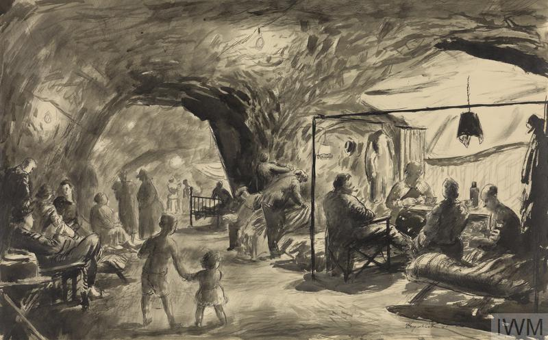 a view of civilians sheltering in the caves. On the right a family sit around a table with a thermos of tea. Next to them are two figures making up a camp bed. Further into the caves is a figure sitting on an iron bedstead. Men and women sit chatting in deck chairs along the left wall.