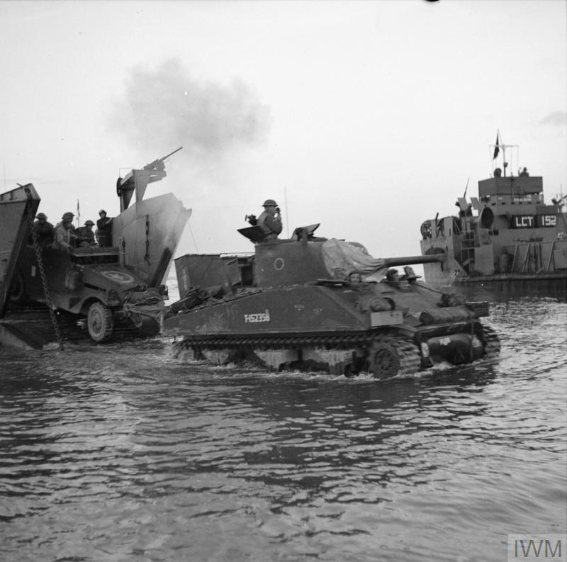 A Sherman tank comes ashore from a landing craft at Anzio, 22 January 1944.