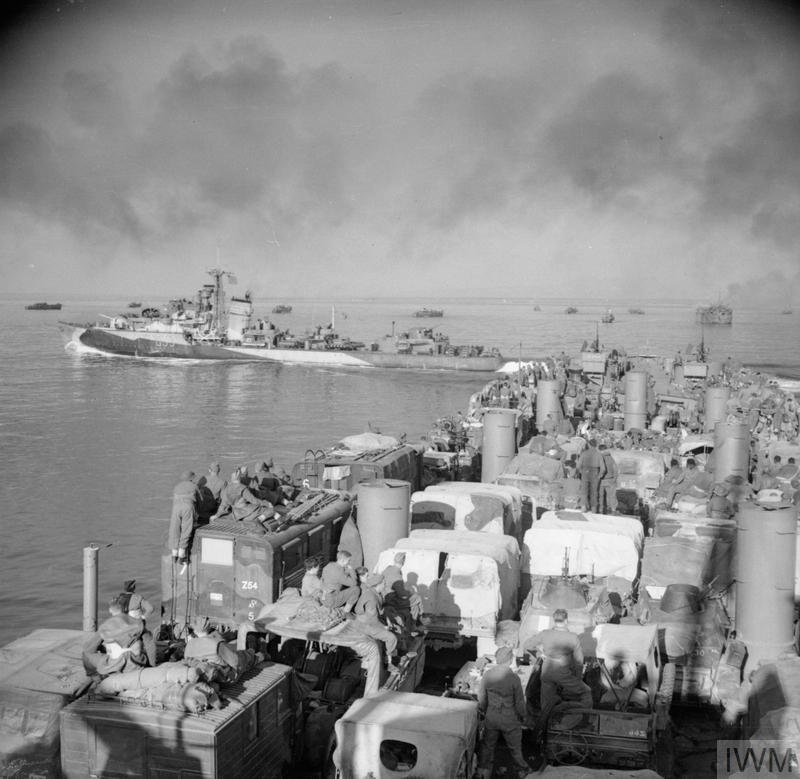 A destroyer passes close to a landing ship, packed with vehicles, approaching Anzio, 21-22 January 1944.
